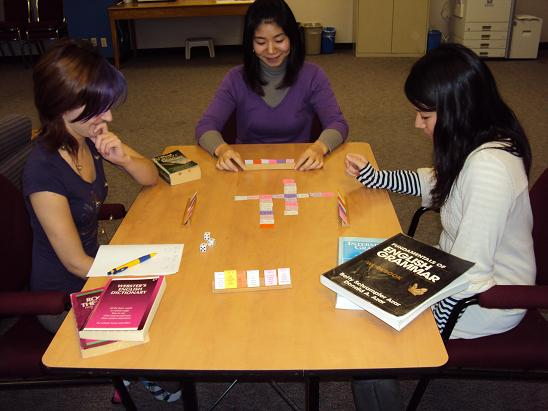 Picture of students writing English Sentences with the Sentence Master word Cards